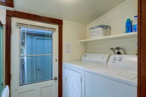 Laundry Area with door to back deck and storage